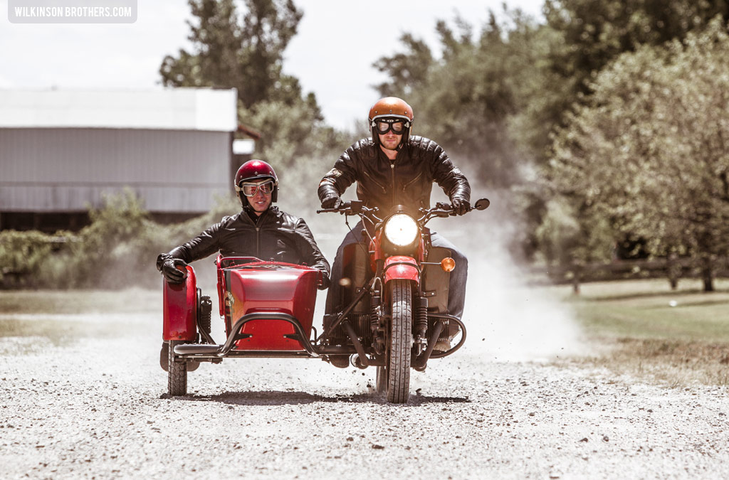 The Wilkinson Brothers riding their Ural sidecar motorcycle.